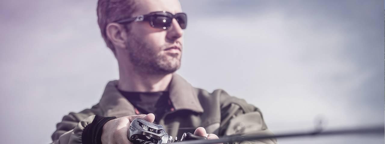 a-man-fishing-rod-sunglasses